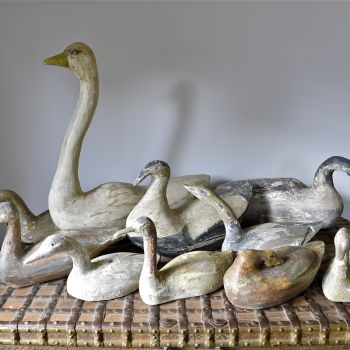 collection of wooden decoys